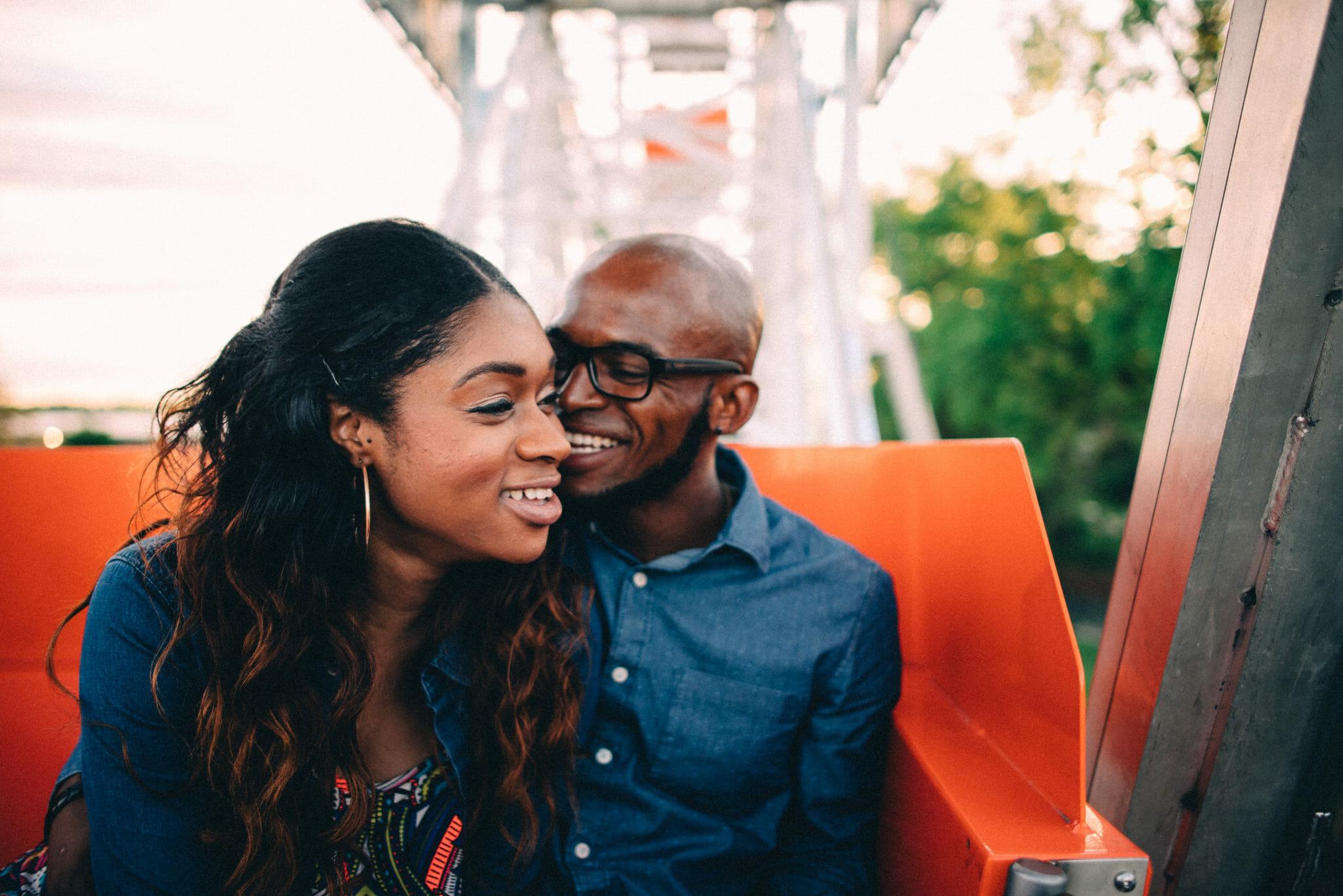 couple laugh on ferris wheel