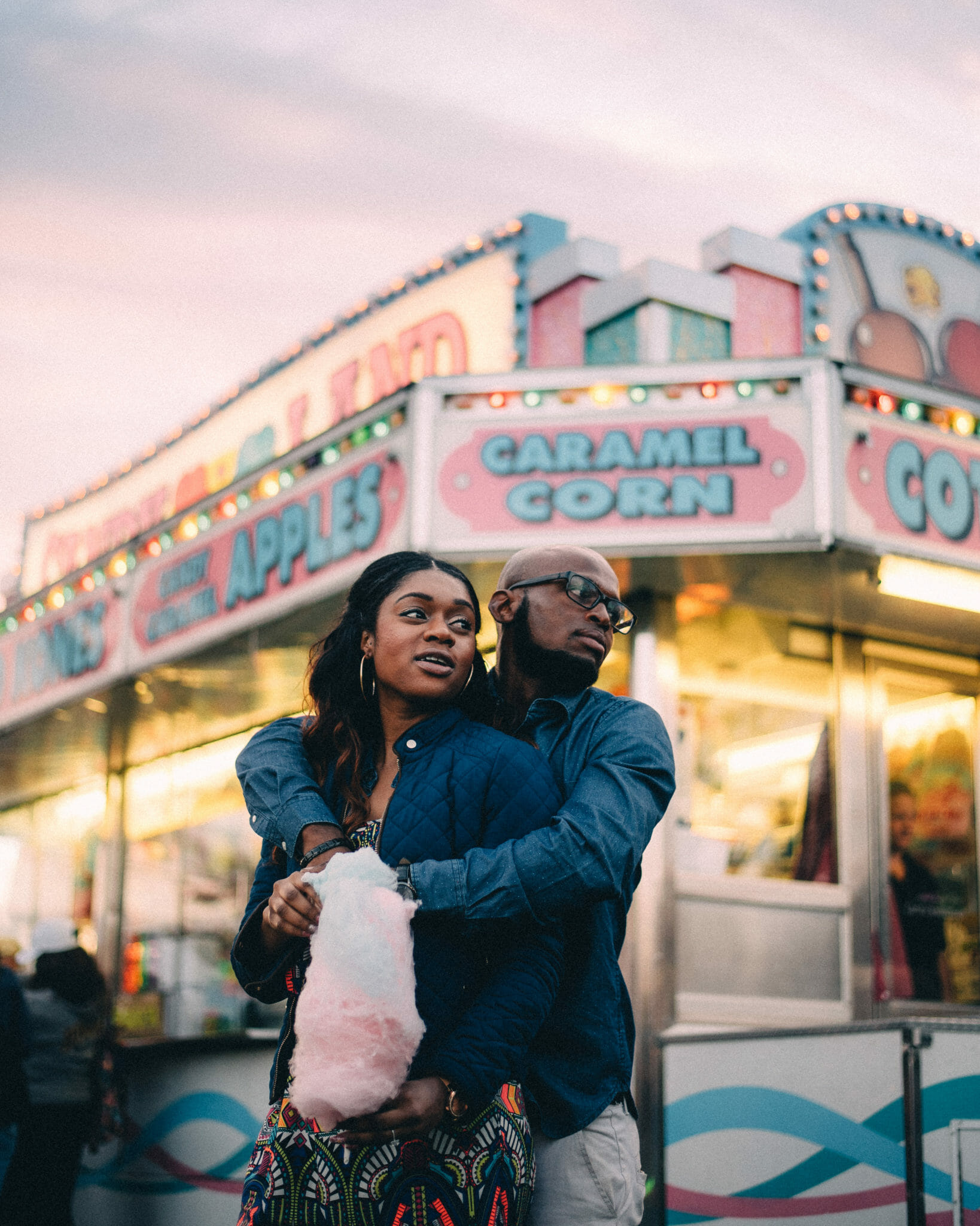 couple eating cotton candy at spring fair