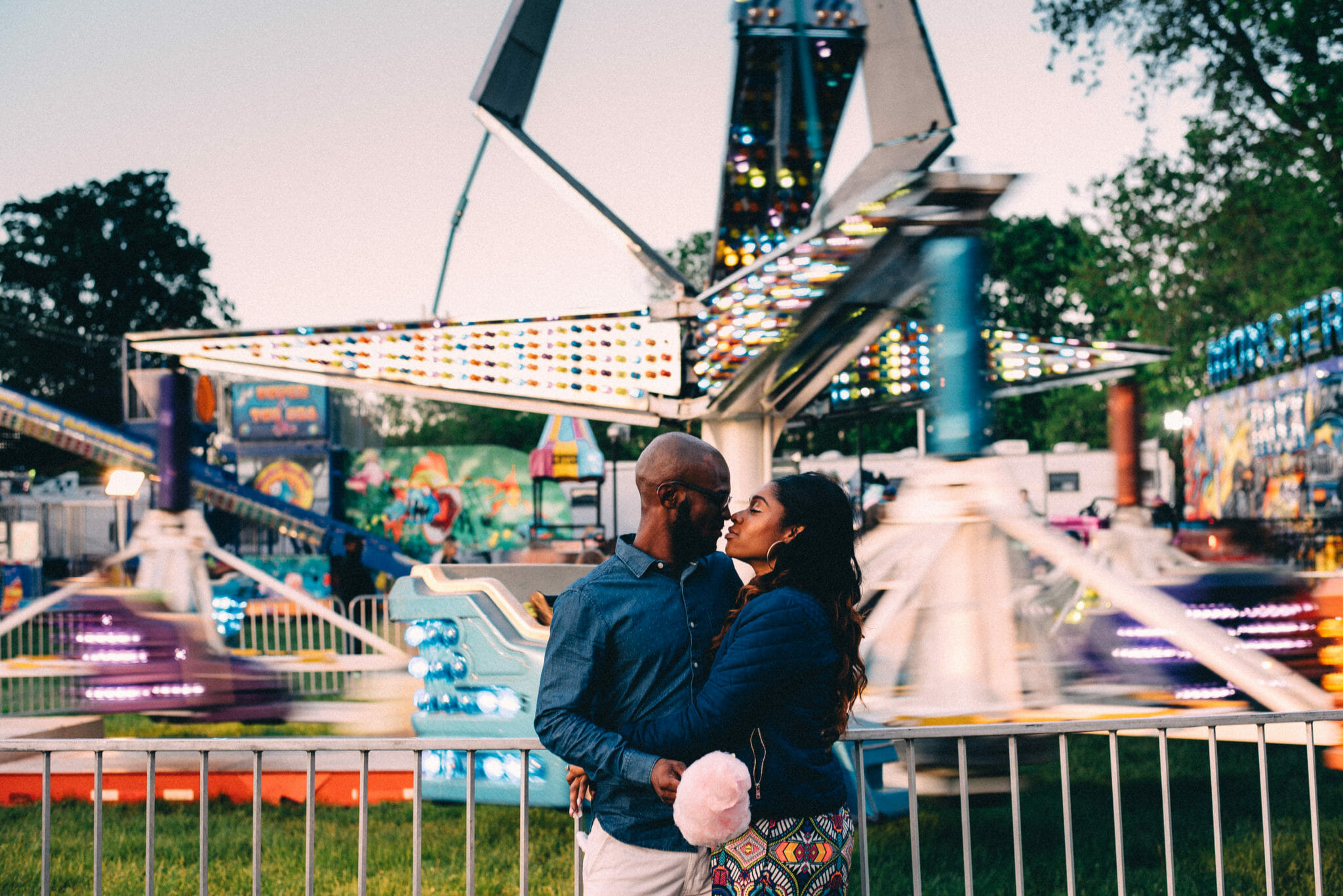 couple kiss in front of brooklin spring fair ride