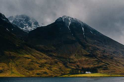 Loch Achtriochtan with small house under mountain