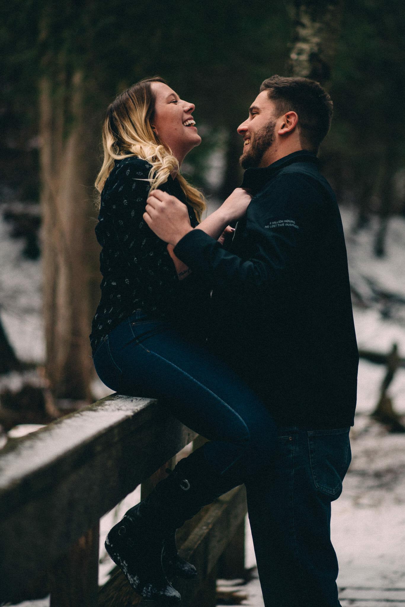 boyfriend and girlfriend laugh together heber