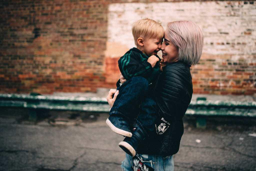tattooed mom laughs with son oshawa