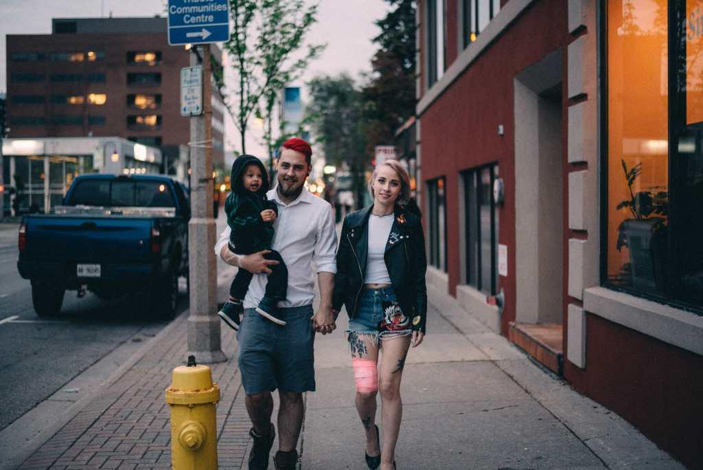 tattooed family walks down city street toronto