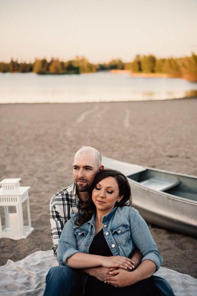 alliston couple cuddle on earl rowe beach by canoe