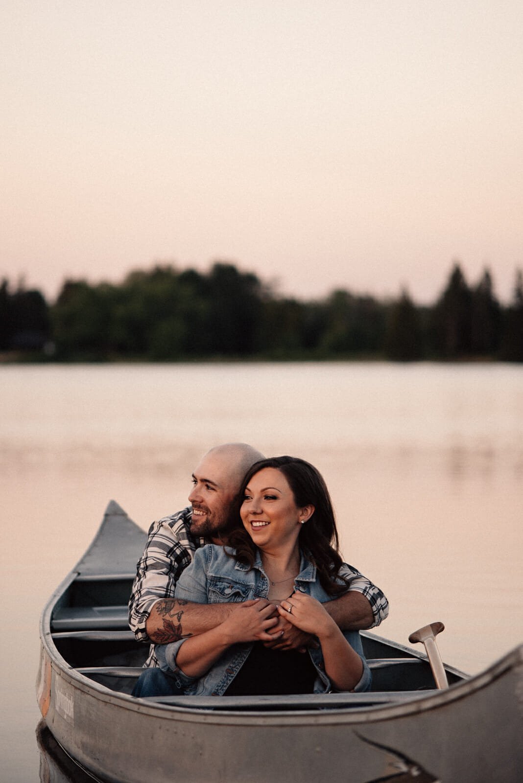couple laugh while canoeing in alliston