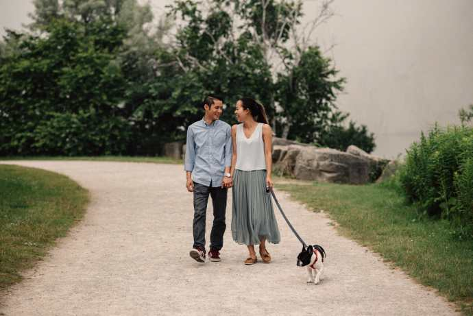 couple walk their dog on path under cathedral bluffs