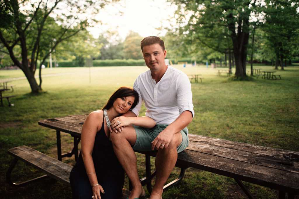 married couple sit on picnic bench at sibbald point