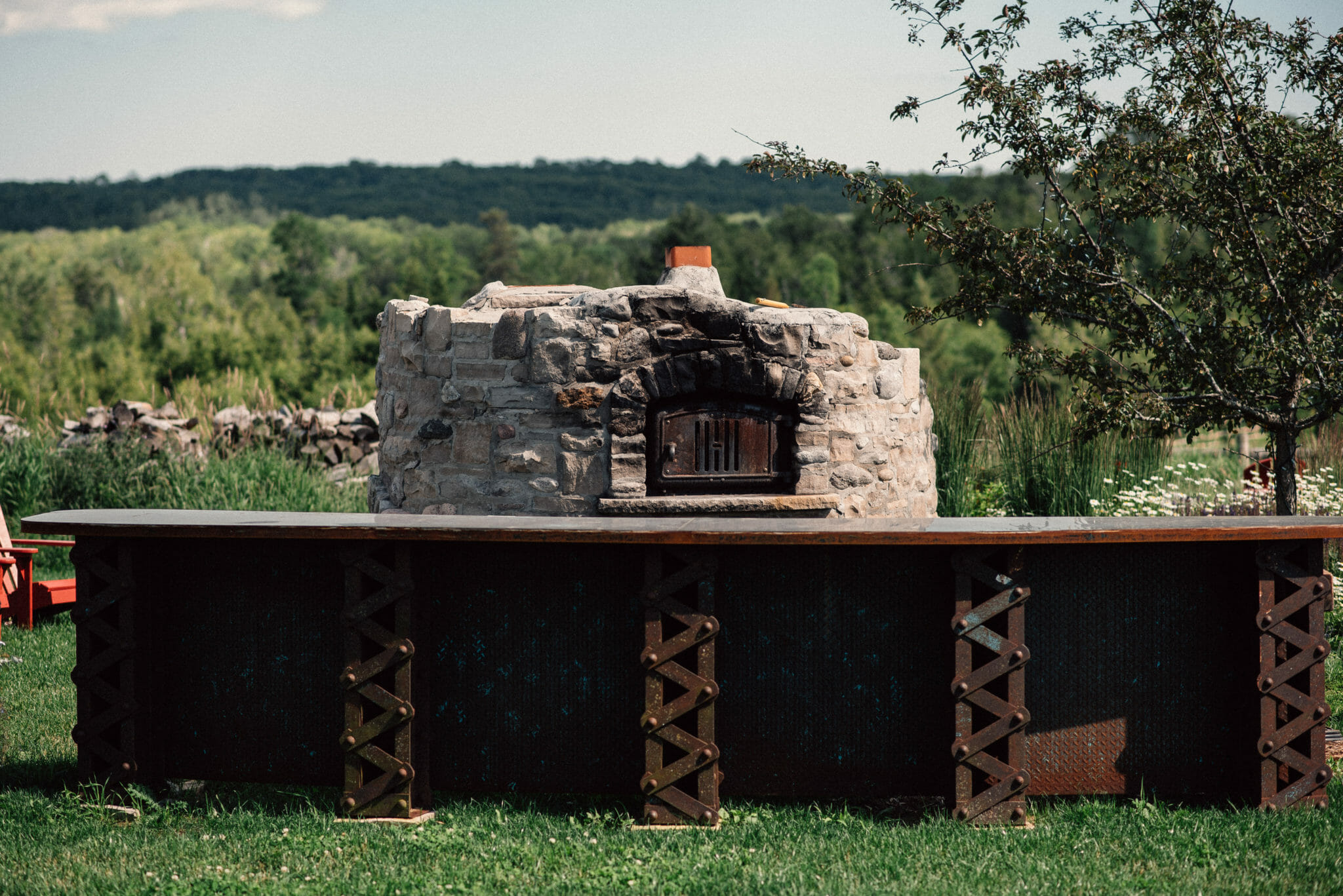 outdoor stone oven with bar wedding venue