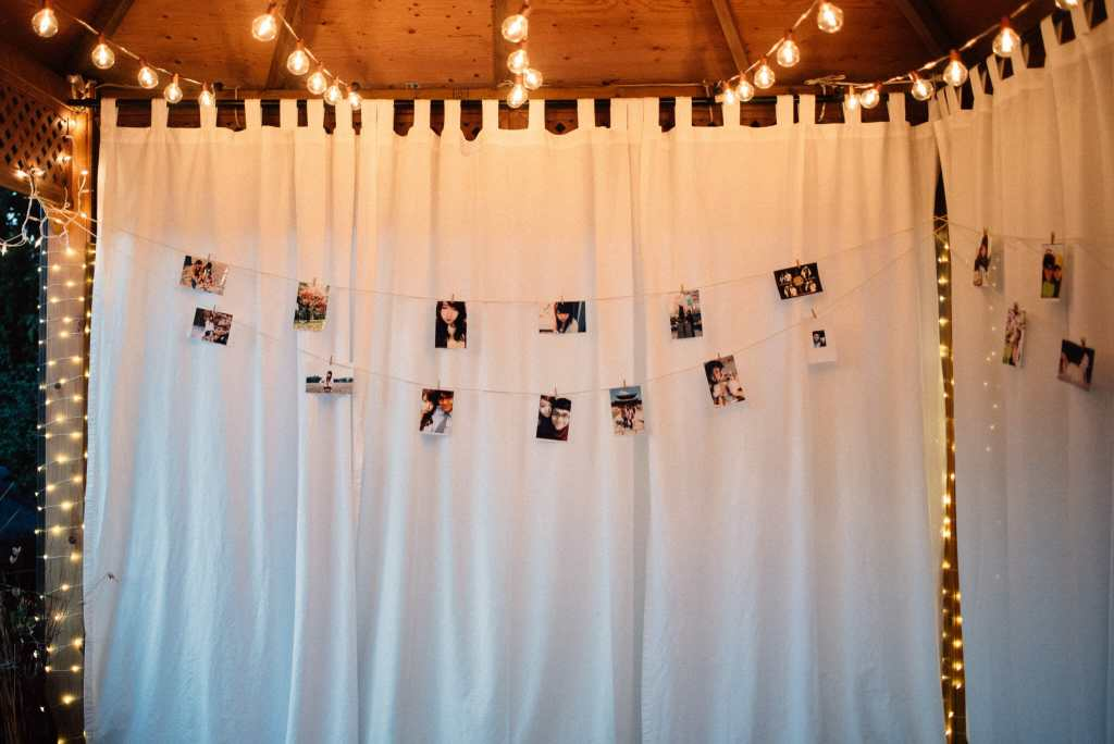 string lights and photos set up in gasebo