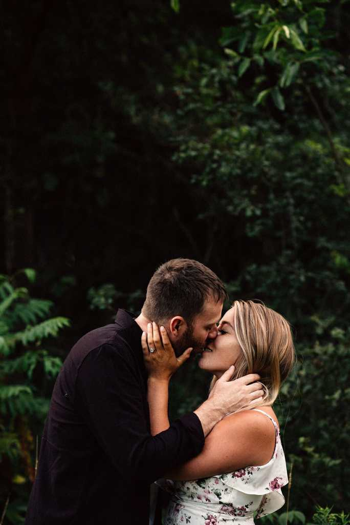 engaged couple kiss at bowmanville photo session