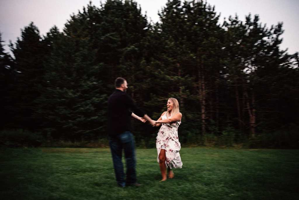 engaged couple play around in bowmanville