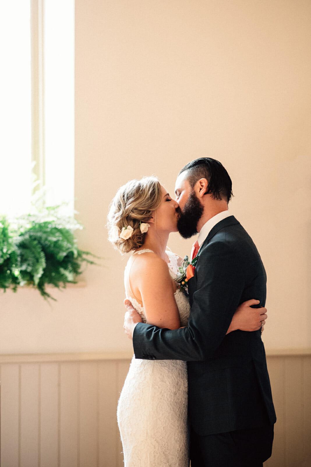 first kiss wedding photo at enoch turner schoolhouse