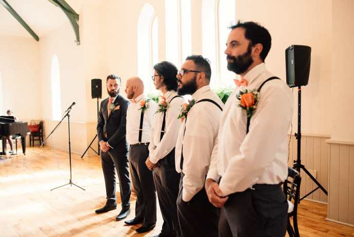 groomsmen wait for the bride at wedding ceremony