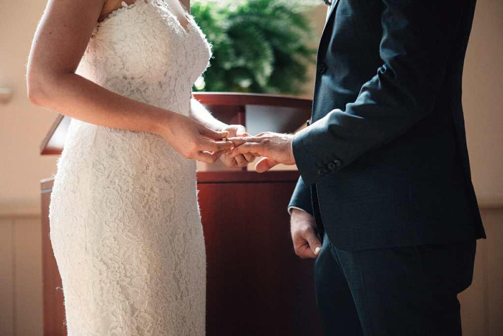 bride and groom exchange rings at toronto wedding