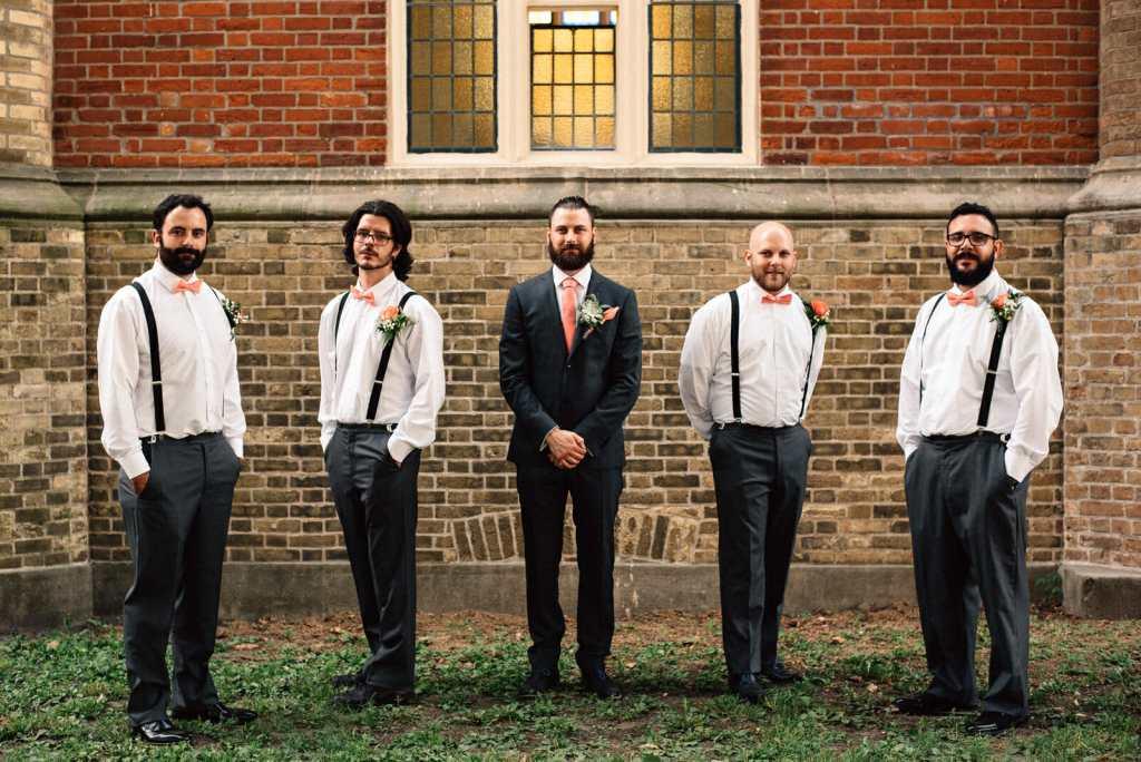 groomsmen group photo outside of little trinity church toronto