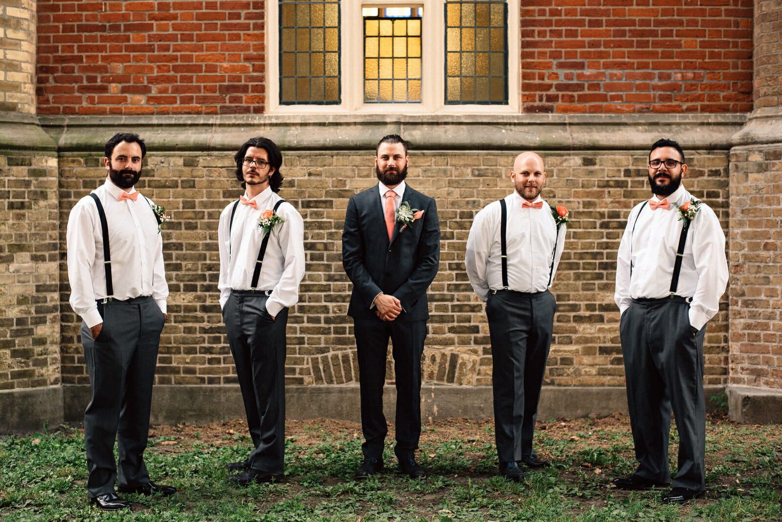 groomsmen group photo outside of little trinity church toronto