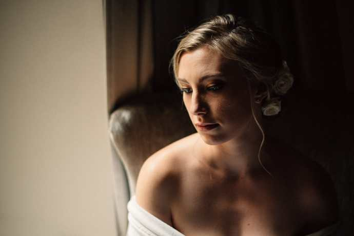 bride sits by window in the king edward hotel toronto
