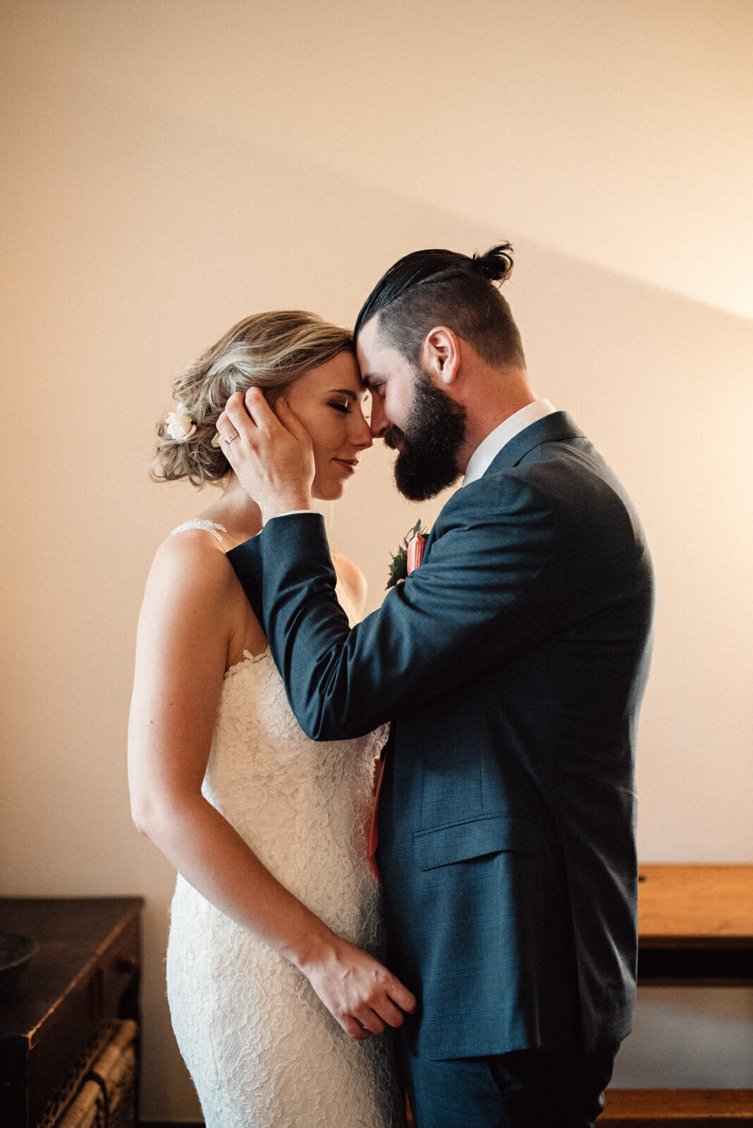 bride and groom share an intimate and quiet moment in enoch turner school