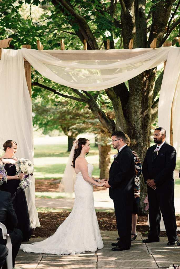 bride and groom exchange vows at outdoor wedding venue oshawa