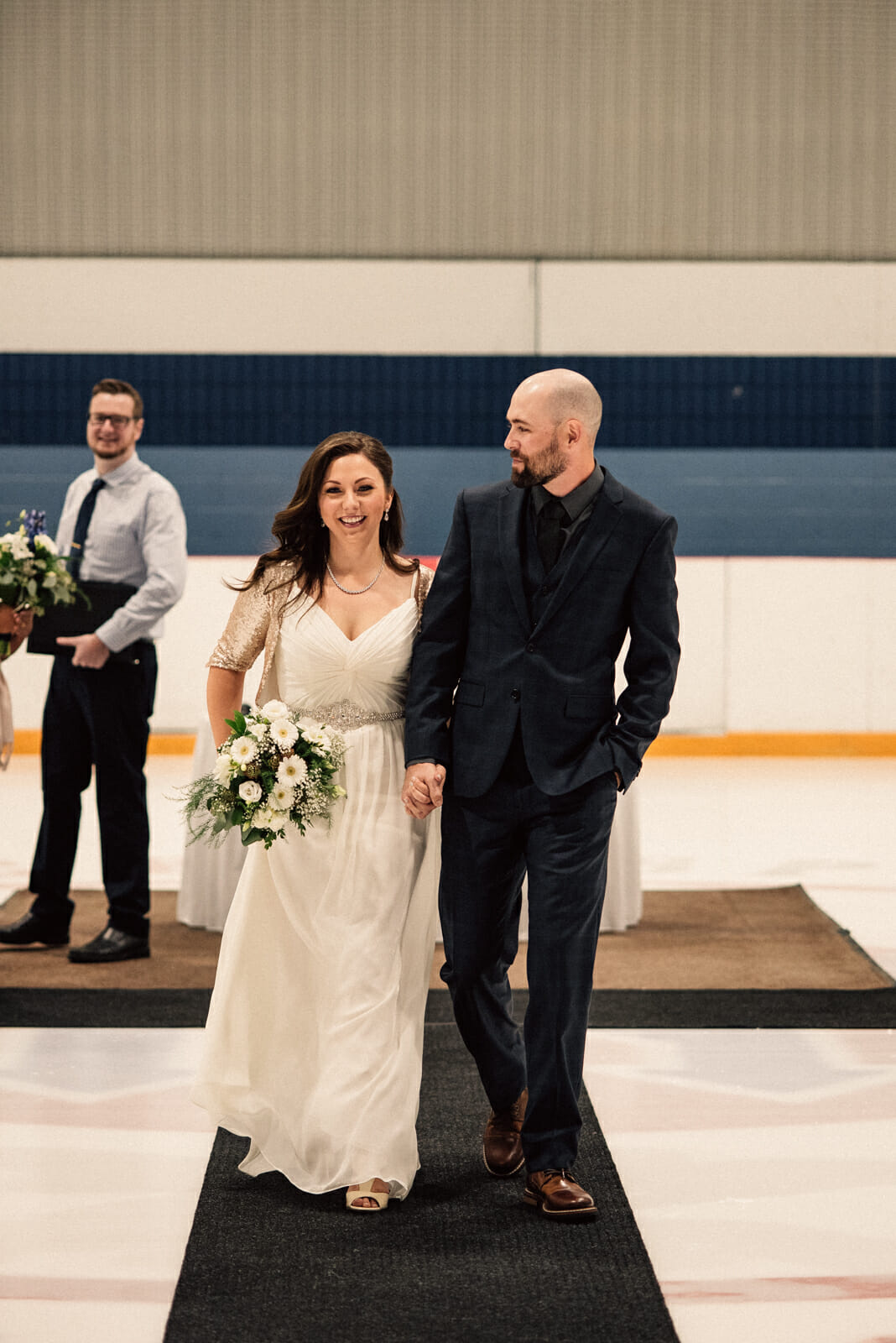 newlyweds walk down aisle on centre ice