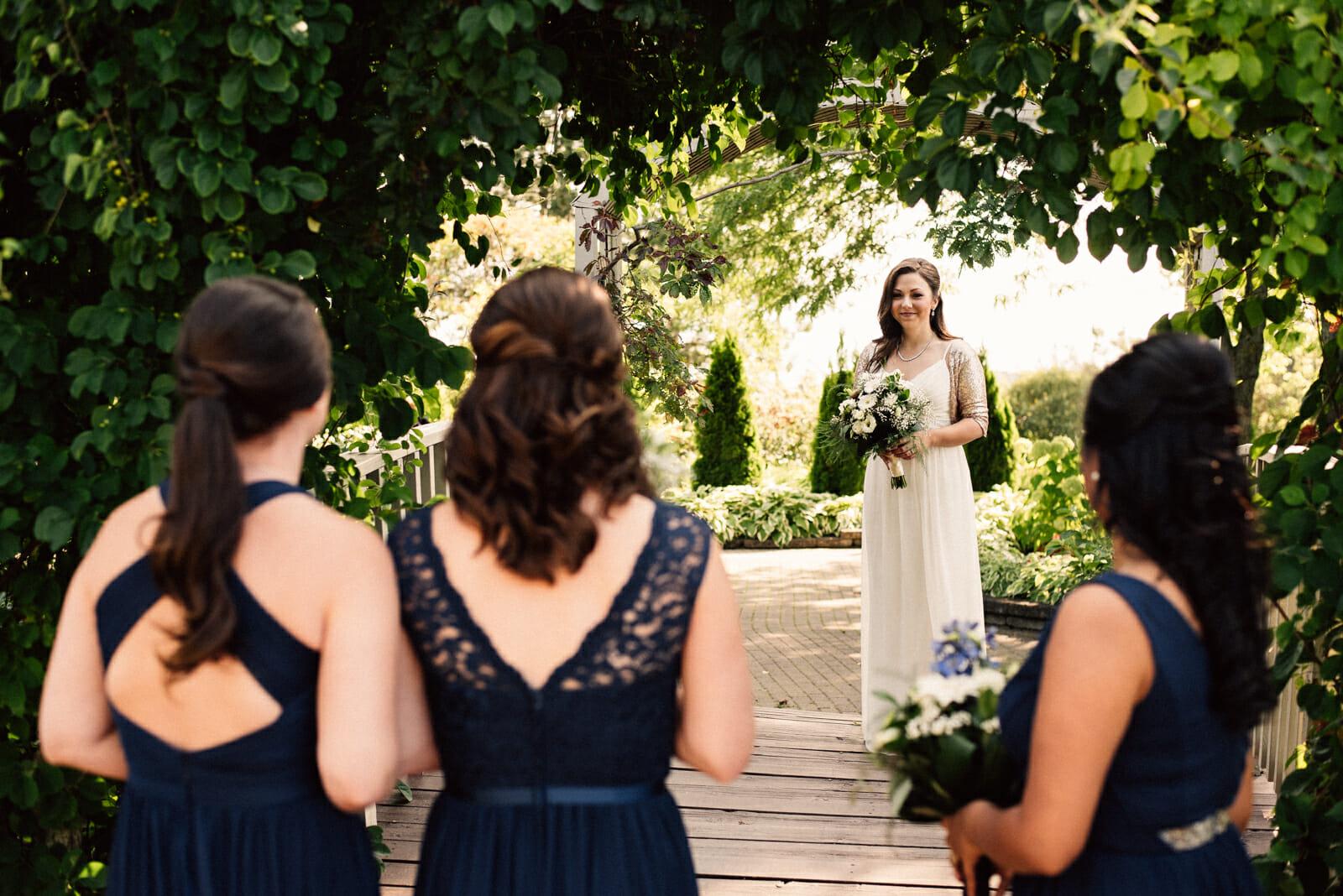 bridesmaids look at bride