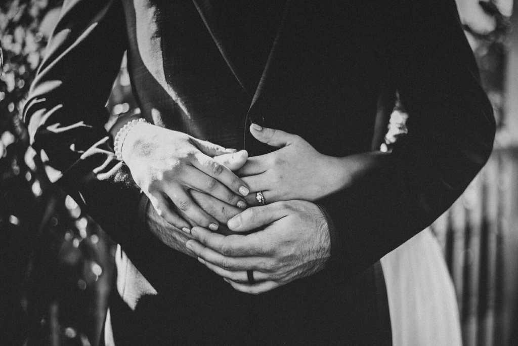 hands of newlyweds on wedding day