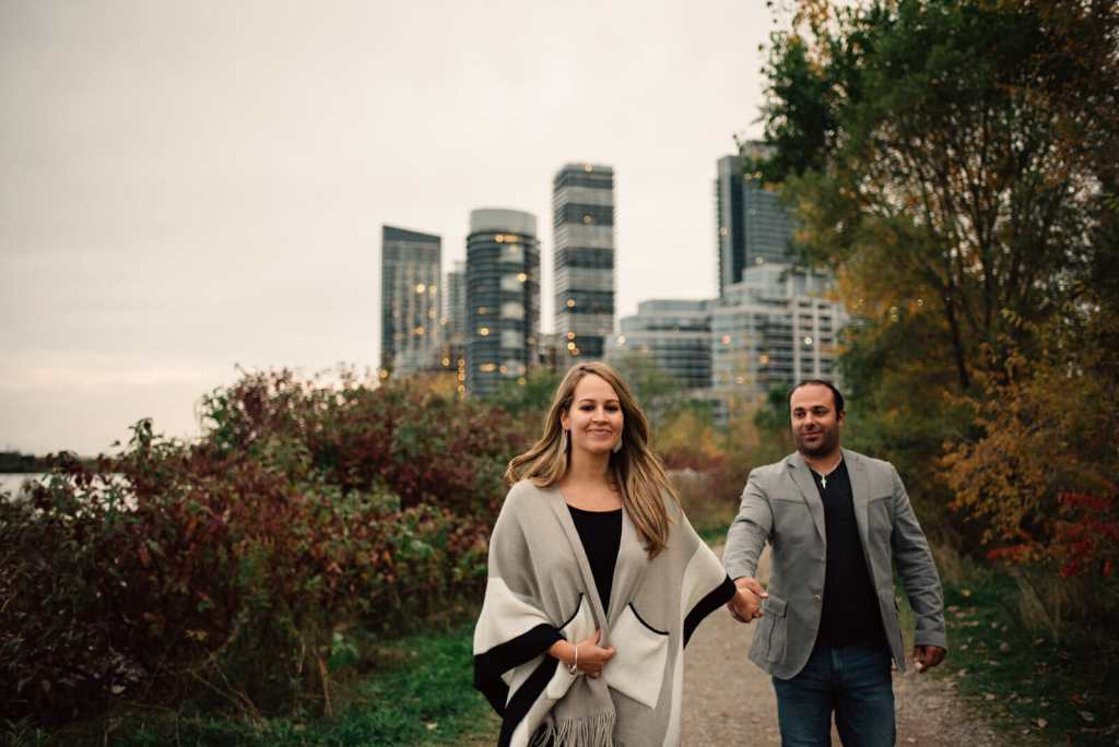 couple walks together in city park