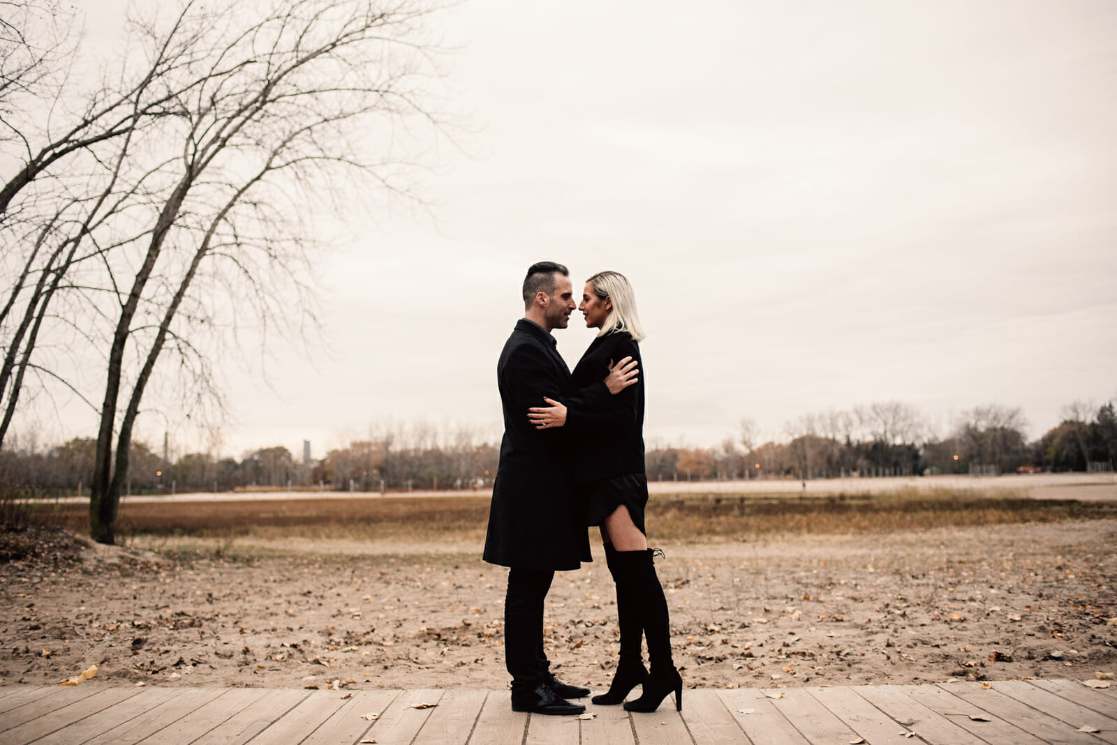 couple hug on the boardwalk during engagement photography