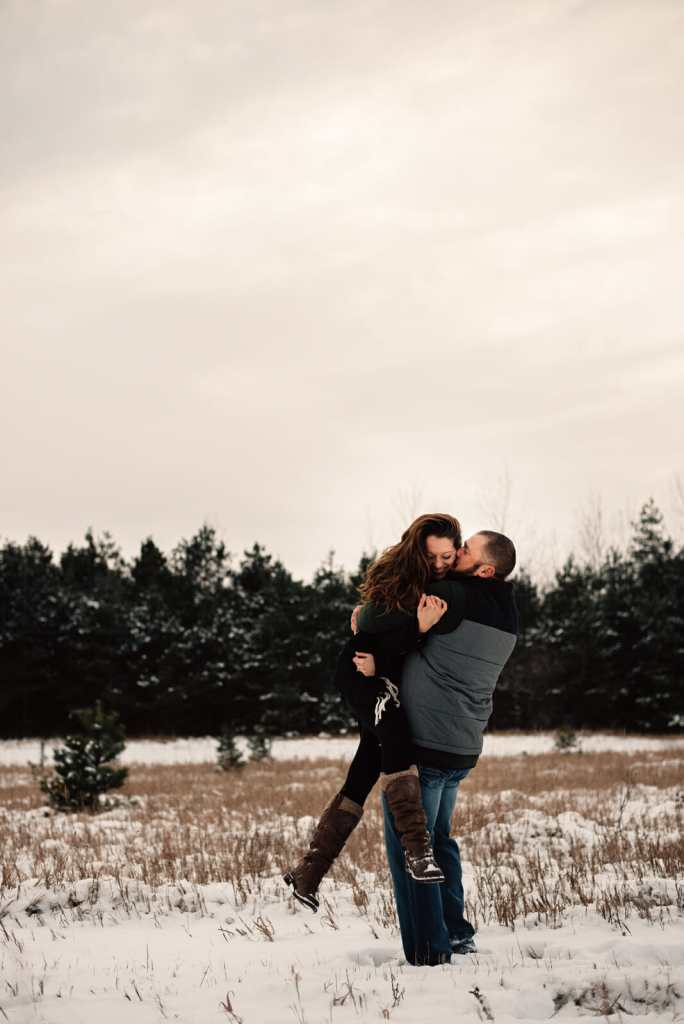 couple acting silly during engagement session