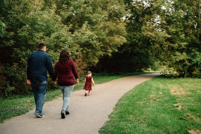 young family walks down path at local whitby park