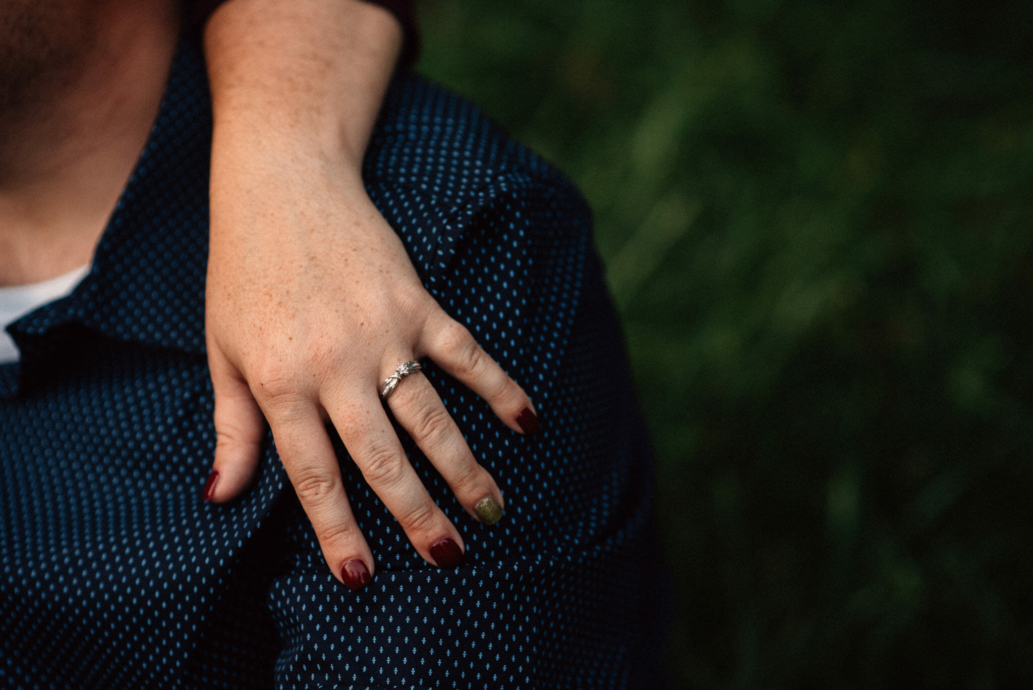 engagement ring on finger of fiancee