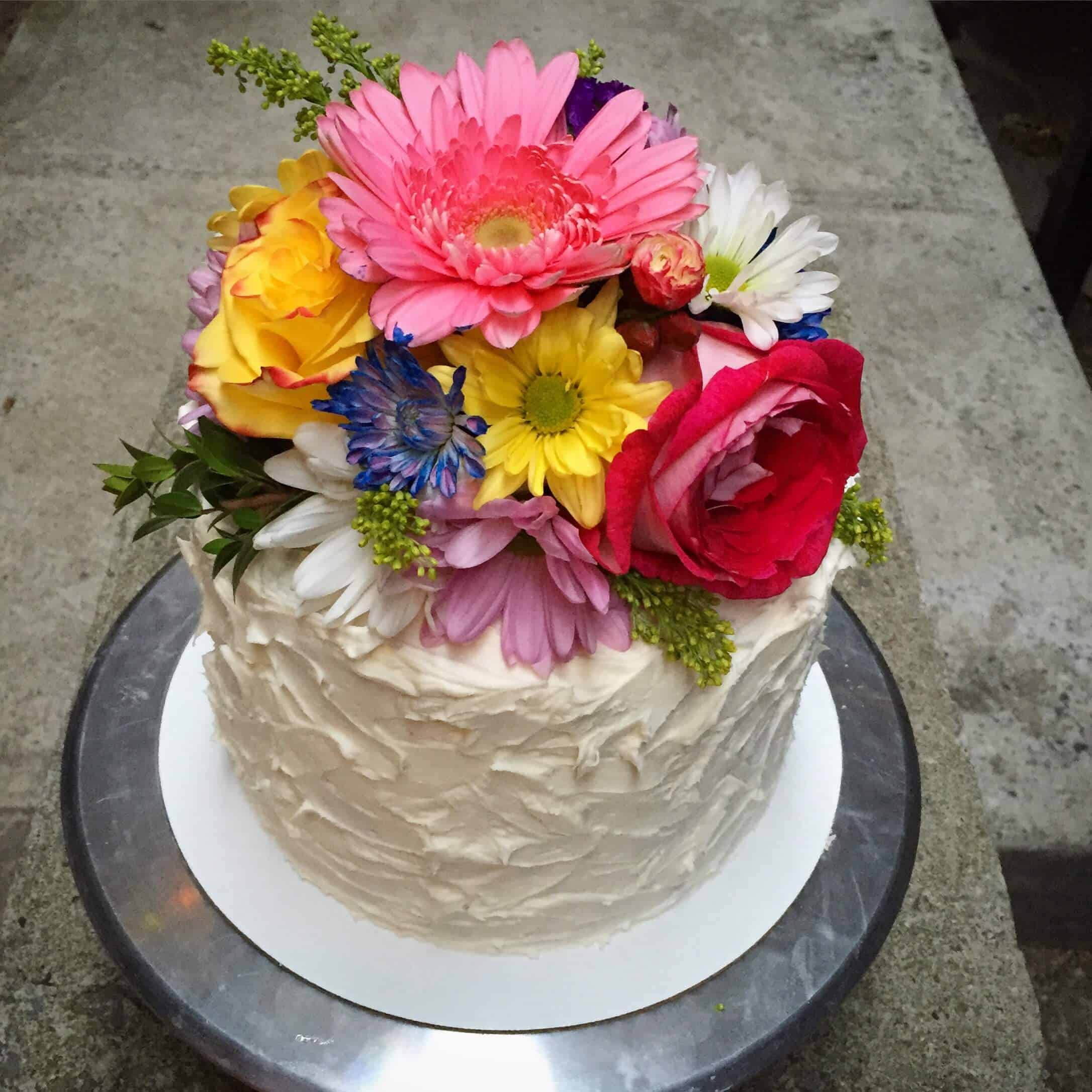 How to put fresh flowers on a cake chelsweets to decorate the top of the cake with flowers gather a beautiful bouquet green floral tap sharp scissors and a thin wire cut the flowers at the top of izmirmasajfo