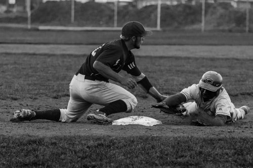 Noah Westerhuis, the Chemeketa Storm's first baseman, tags out a Central Oregon base runner as he dives back to the base.