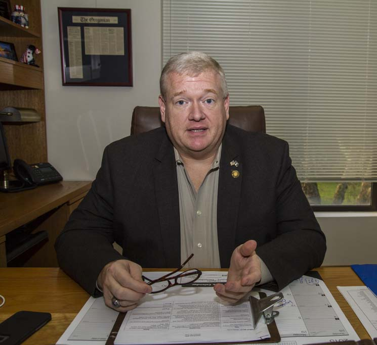 Paul Evans, at his desk at the Oregon State Capitol