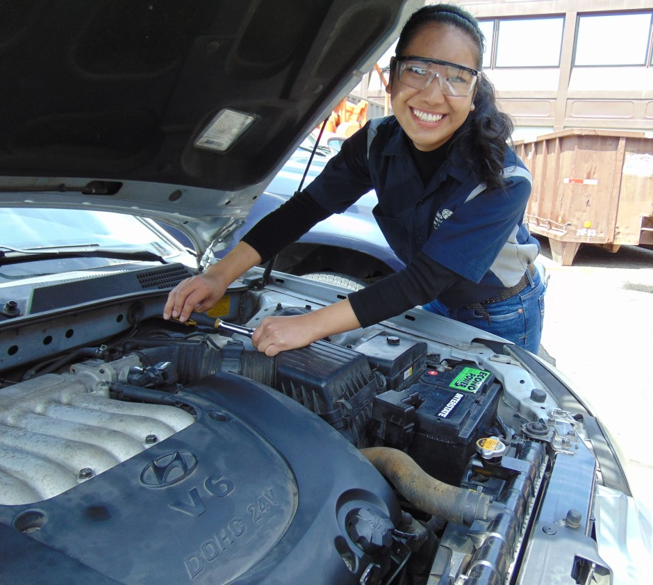 Megan Arriola, a second-year automotive technology student, finishes repairs on a vehicle in Bldg. 4's automotive lab.