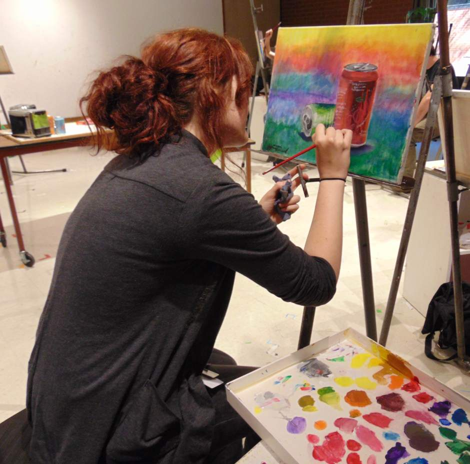 Chemeketa student Jazmine Deckard works on a painting while exploring the use of colors.