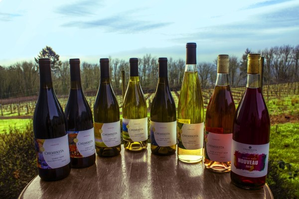 Photo of eight Chemeketa Cellars bottles of varying vintages