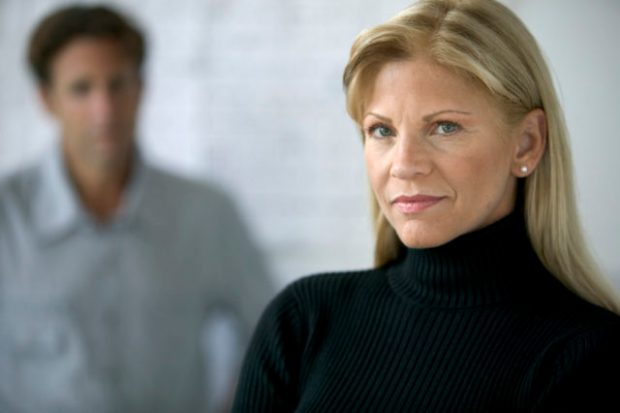 Woman with Man in Background