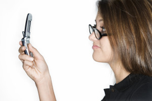 Young Woman Dialing Cell Phone