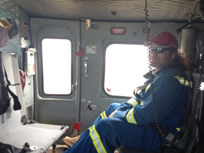 Dr. Court Sandau in a helicopter to travel to wildfire site