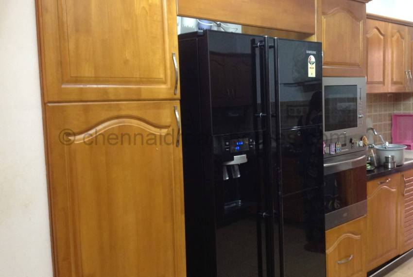 One side of Kitchen with Refrigerator view