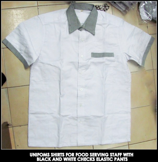 White shirt with checkered collar and sleeve round