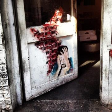 A door of despair along Brick Lane, London.
