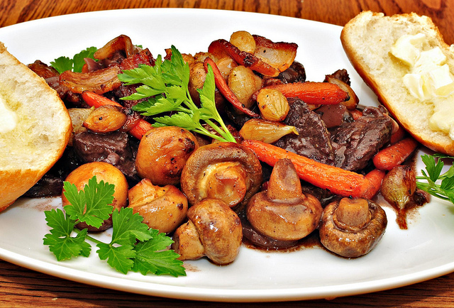 """Mmm... beef braised in red wine with pearl onions, baby carrots and mushrooms"" by  jeffreyw is licensed under CC BY 4.0"
