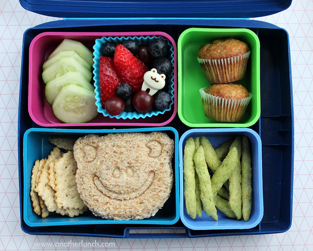 """Laptop Lunches with frog face sandwich and mini muffins"" by  Melissa is licensed under CC BY 4.0"