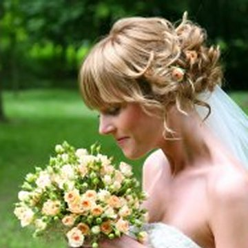 short curly bridal hairstyle for blond hair