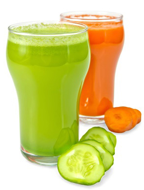 Photograph of classes of raw juice, green cucumber and orange carrot in preparation for a one day raw juice fast