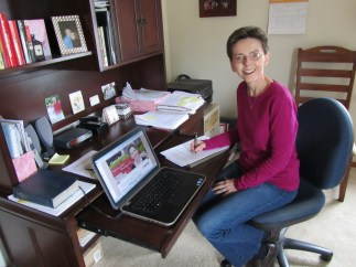 In my home office signing contract with Credo Communications. Karen Neumaier is my agent.