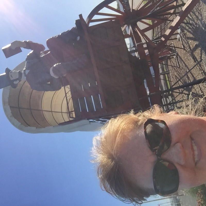 Cheryl Boglioli on Route 66 with Worlds Largest Covered Wagon