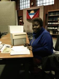 Cheryl signs over her papers to the Schomburg